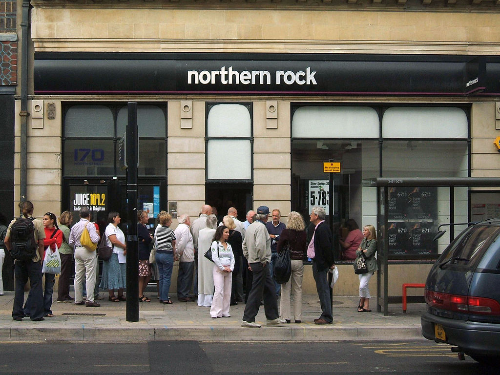A small line of customers (presumably anxious investors and savers) outside a branch of Northern Rock during the 2008 financial crisis