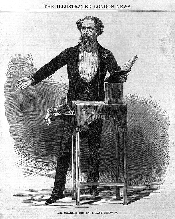 Illustration showing Charles Dickens standing behind his reading desk, performing his last public reading