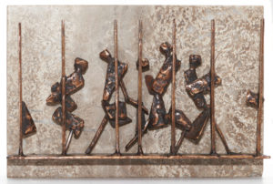 A bronze sculpture mounted on marble showing a series of people