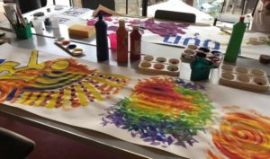 A table set up with painting crafts for children.