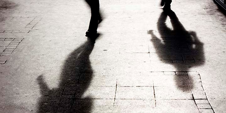 The shadows of two figures walking