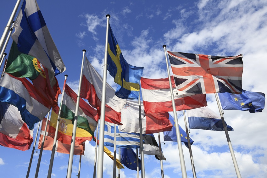 The flags which make up the European Union against a blue sky