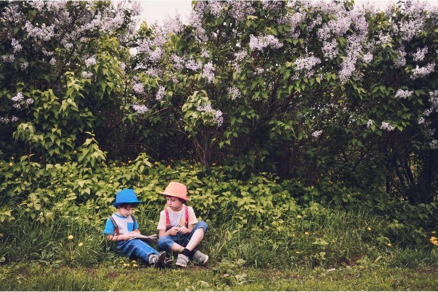 Children sat outdoors